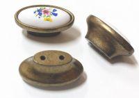 Knopka porcelánová 33x57 / staromosaz